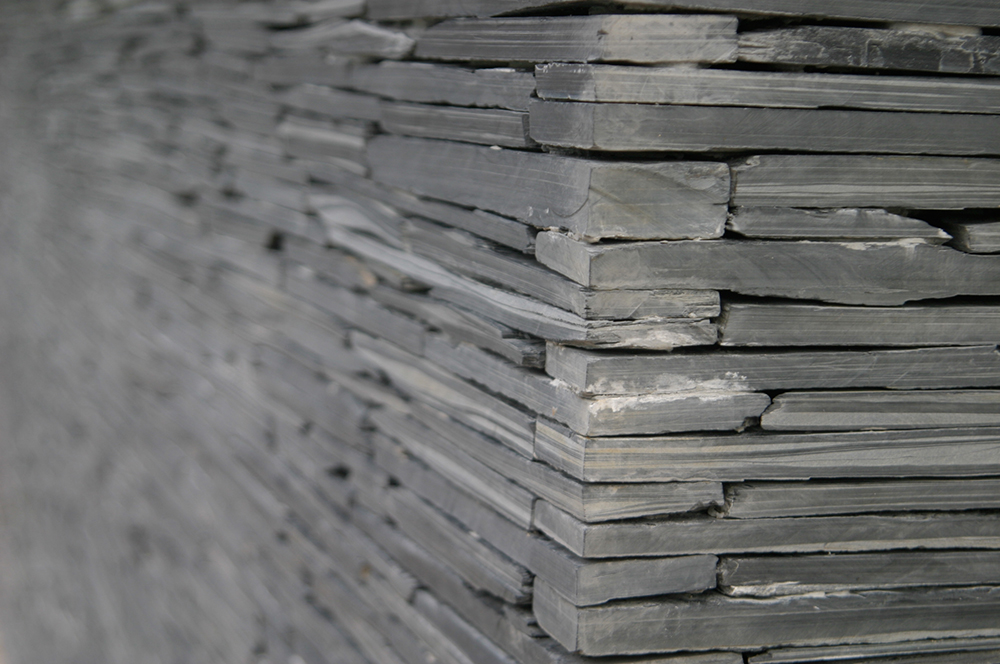 an new wall cover with dark grey stones